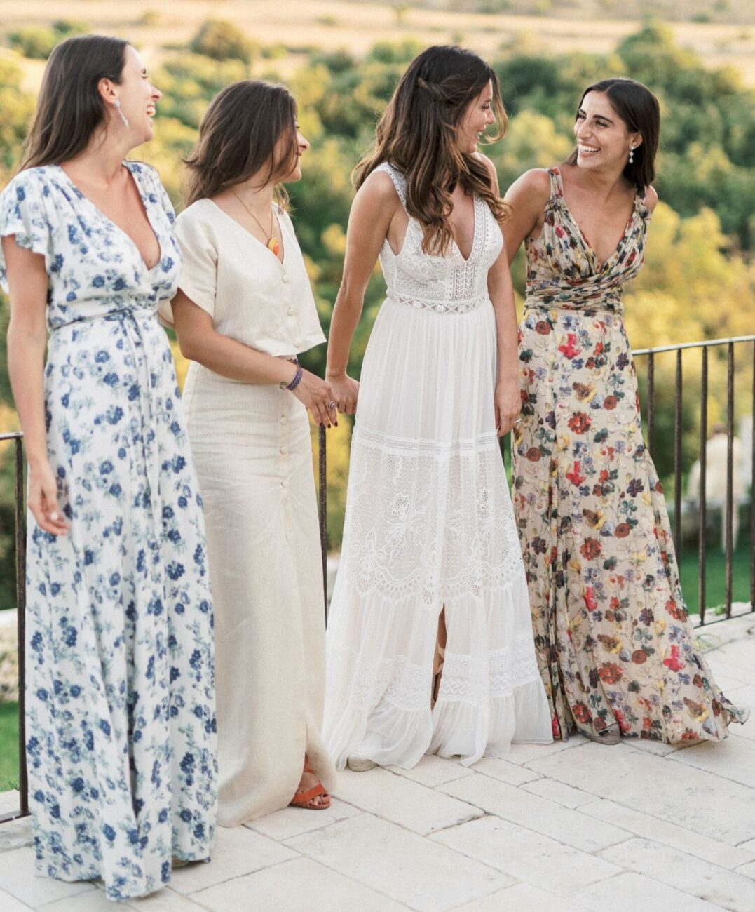 destination wedding in Italy - bride and her friends smiling and posing for photographs after the wedding ceremony in tuscany