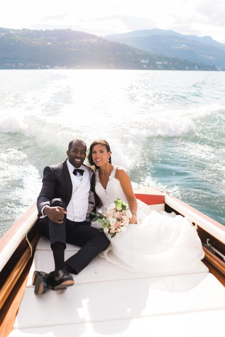 destination wedding in Italy - couple on a boat in lake como going to their wedding party